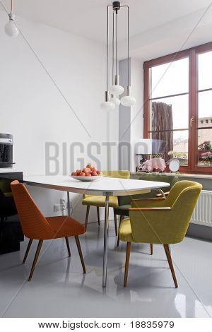 modern dining room with oldschool chairs