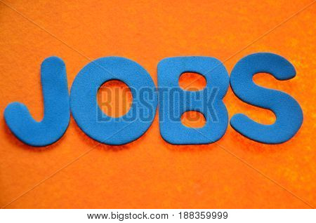 word jobs on a  abstract  orange background
