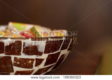 candies and little chocolate bars in a bowl made from coconut