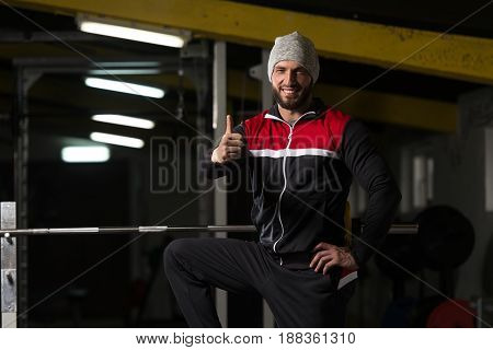 Man In Track Suit Showing Thumbs Up