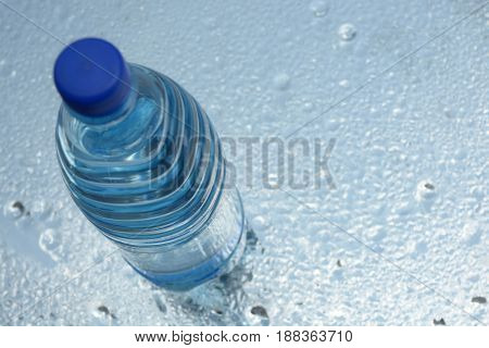 A bottle of pure water on water background