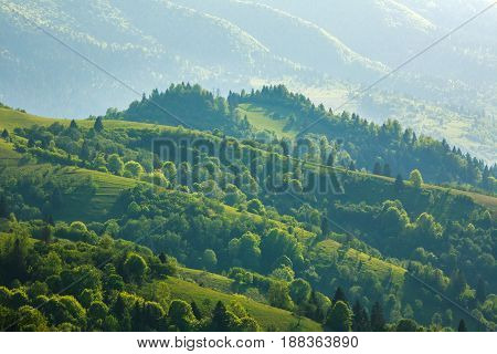 Rural landscape village and fields in the mountains at sunlight