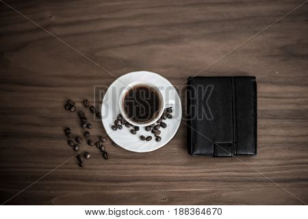 Saved Coffee In A Cup With A Wooden Background, Green Coffee Around Cups, Coffee Bean On Wooden Text