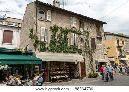 SIRMIONE ITALY - MAY 5 2016: The holiday resort town of Sirmione on Lake Garda Lombardy Italy.