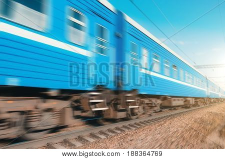 Passenger cars passing by at high speed railway