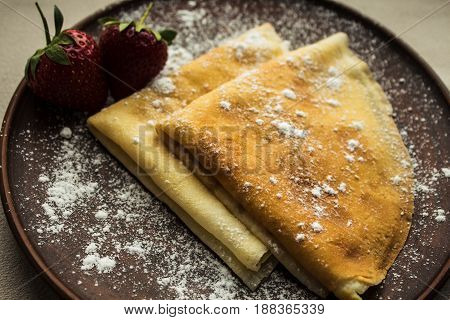 Pancakes With Strawberries And Powdered Sugar