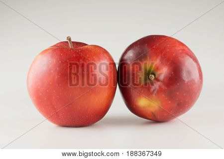 Large ripe red apples on a white background