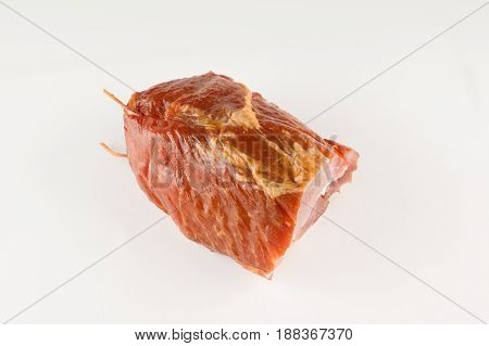 piece of smoked aromatic meat lies on a white background