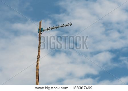 3G Repeater Lonely Set In The Countryside On The Background Of Cloudy Sky