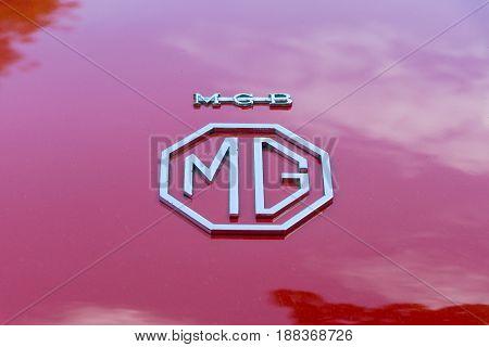 BERLIN GERMANY - MAY 17 2014: The logo of the sports car MG MGB 1800 convertible. 27th Oldtimer Day Berlin - Brandenburg