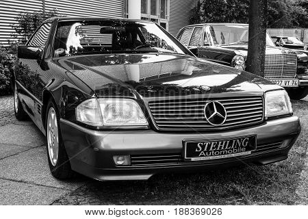BERLIN GERMANY - MAY 17 2014: The two-door roadster Mercedes-Benz 300SL (R129). Black and white. 27th Oldtimer Day Berlin - Brandenburg