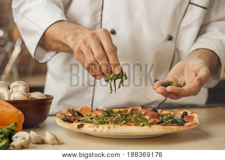 Bakery chef cooking bake in the kitchen professional decorating