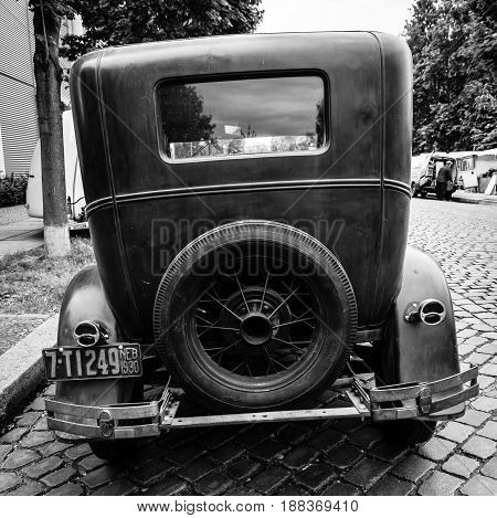 BERLIN GERMANY - MAY 17 2014: Oldtimer Ford Model A Deluxe Tudor Sedan (1930). Black and white. Rear view. 27th Oldtimer Day Berlin - Brandenburg