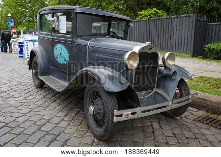 BERLIN GERMANY - MAY 17 2014: Oldtimer Ford Model A Deluxe Tudor Sedan (1930). 27th Oldtimer Day Berlin - Brandenburg