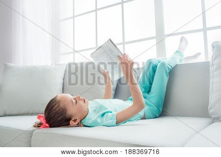 Young teenager girl alone at home childhood reading book
