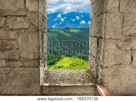 Window in an old fortress overlooking the Caucasus mountains in Sochi in Russia