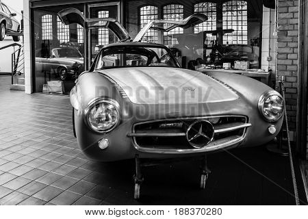 BERLIN GERMANY - MAY 17 2014: Body Mercedes-Benz 300SL (W198) in the restoration workshop of Mercedes-Benz. Black and white. 27th Oldtimer Day Berlin - Brandenburg