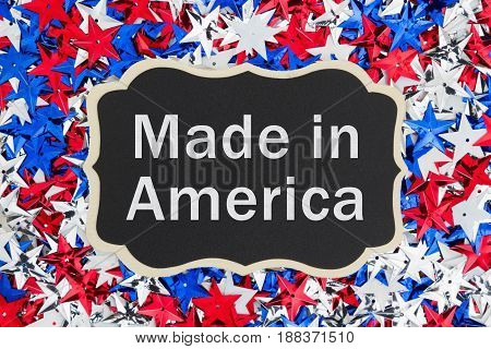 Made in America text with Patriotic USA red white and blue stars on a chalkboard