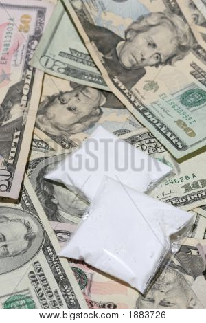 Baggies of drug sitting on top of piles of US currency poster