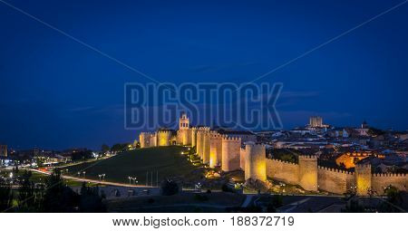 Panoramic view of the historic city of Avila, at the blue hour, in Spain. the old city of Avila and its extramural churches were declared a World Heritage site by UNESCO