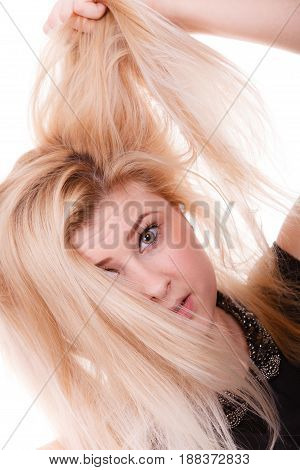 Blonde Woman Holding Her Dry Hair