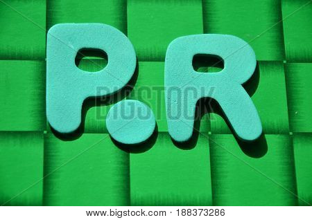 word pr on a  abstract green background