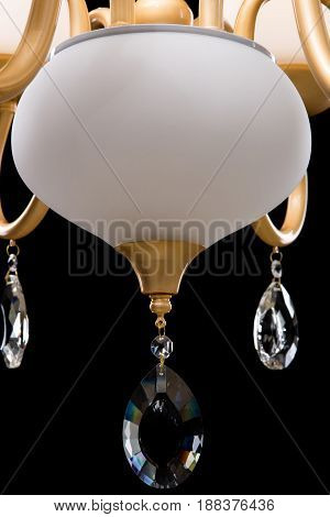Classic Chandelier for interior decoration of the living room. White Chandelier close-up photo isolated on black background. modern a piece of interior for designers.