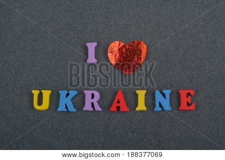 I love UKRAINIAN word on black board background composed from colorful abc alphabet block wooden letters, copy space for ad text. Learning english concept
