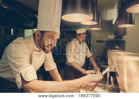 Male japanese restaurant chef cooking in the kitchen reading order