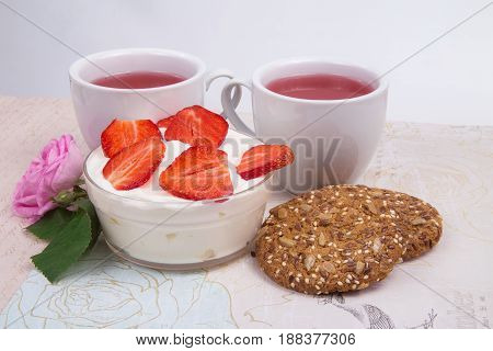 strawberry in sour cream with white cups filled with compote