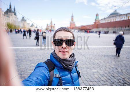 Cheerful man making selfie on the street