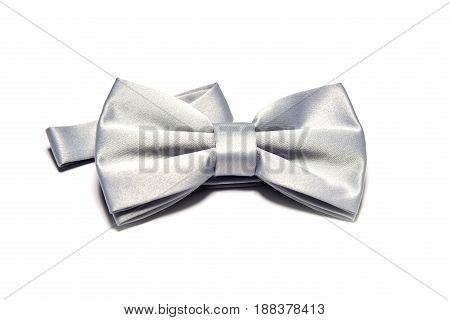 Overhead view of a silver or light grey bow tie