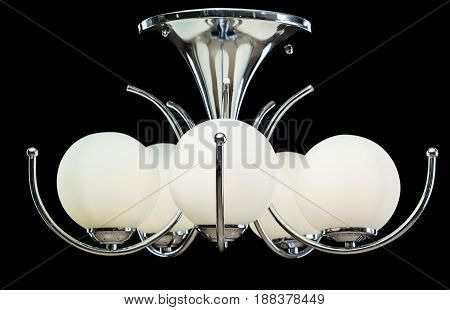 Modern Chandelier for interior decoration of the living room. Chandelier isolated on black background. Silver modern piece of interior for designers.