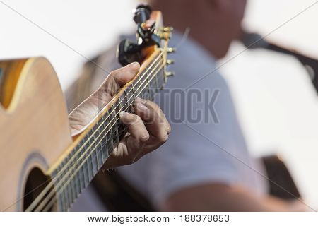A playing guitar on stage . A photo