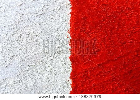 Background or texture of red-white painted rough wooden board close-up with vertical line and drops paint