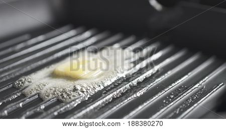 grill pan with melting butter, wide photo