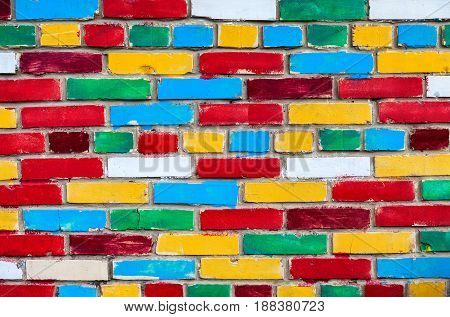 Colorful brick wall from multi colored bricks as a creative background texture