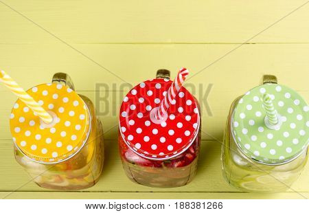 Fresh fruits flavored water healthy detox drinks in jars - top view