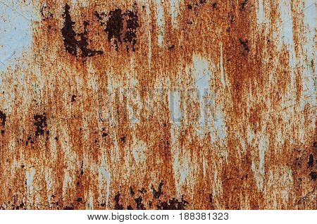 Corroded white metal background. Rusty metal background with streaks of rust. Rust stains. The metal surface rusted spots. Rysty corrosion.