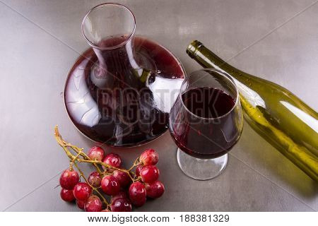 Carafe Of Red Wine And One Glass