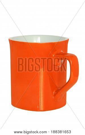 Orange ceramic tea cup isolated on white background.