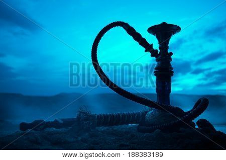 Hookah, Traditional Arabic Waterpipe, Direct Sunset Light, Outdoor Photo