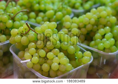 White wine grapes in a market. Top view