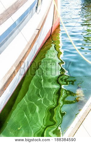 Abstract colorful water reflection of a boat