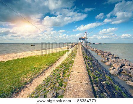 Stone Path Leading To The Lighthouse On The Sea Coast