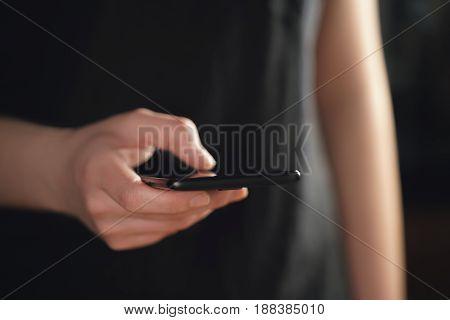 female teen hand holding smartphone closeup shot, shallow focus