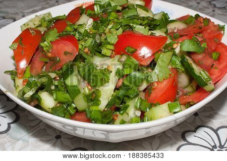 Salad of fresh tomatoes, cucumbers, green onions and parsley