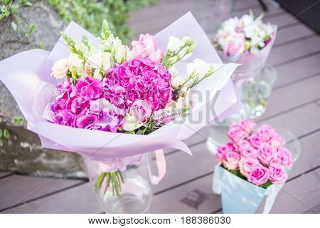 bouquet with pink fresh flowers in glass vase