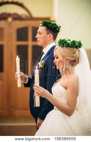 The bride and groom give a vow of love in the church.