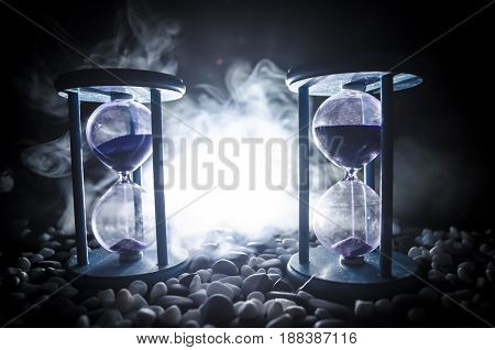 Time Concept. Sand Passing Through The Glass Bulbs Of An Hourglass Measuring The Passing Time As It